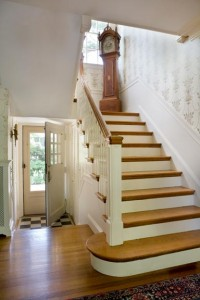 Though it's not uncommon to find a grand, sweeping staircase in a Colonial Revival home, the earliest examples are akin to Charlotte Hart's stairs—boxed in, paneled, and supremely functional.