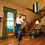 The home's airy entry accommodates chocolate lab Scarlett and two other happy dogs, in addition to its human owners and guests.
