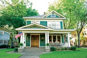 Homeowners Clark Mitchell and J.W. Brasher were guided in their restoration by a 1909 photo of the home—a gift from a descendant of the house's original owner—which clued them in on the home's original cladding and what sort of railing to wrap around the porch.