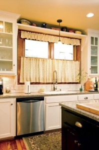 Modern granite countertops and appliances make the kitchen user-friendly, while salvaged wood floors hark to an earlier era.