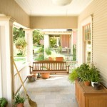 The porch's white beadboard ceiling and slate-tile floor create a cool, shaded outdoor room to combat the sweltering Texas heat.