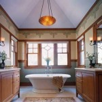 Chicago firm Greene & Proppe Design bumped out this master bathroom in a Shingle-style house to create a light-filled niche for the luxurious vintage pedestal tub. Period-style blown glass light fixtures and an Arts & Crafts frieze enhance the room's authenticity. (Photo: Christopher Lark)