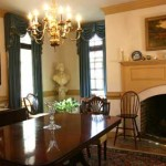 "Barker's antiques—like this family dining room set—are well-suited to the building's Colonial-era formality. ""I happen to enjoy Jeffersonian taste in furniture,"" he says."
