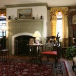 Draperies following Jefferson's own design warm the parlor. The fireplace's modest moldings and capped dentillations are typical of the period.