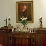 A judicious blend of antiques steeps the formal dining room in history.