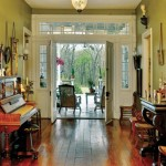 The double front door, bordered by the original transom and sidelights, helps to usher cooling breezes into the foyer.
