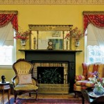 David was able to save the original millwork on the home's two deep-pitted wood-burning fireplaces, which take center stage in both the formal parlor (shown here) and a cozier one where many of the family's heirlooms and collections are displayed.