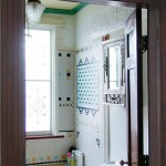 Stuck with a 1970s-era avocado green bathtub, the owners of this Washington, D.C., row house made the most of it by incorporating the color into a vibrant mosaic tile design on the tub surround and wall.