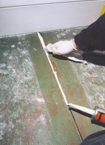 A thinner-soaked rag pushes the caulk tightly in place and cleans up excess that could cause paint to fail.
