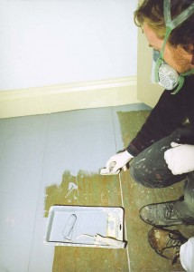 A brush-and-roller technique gives the floor a historic painted finish look.