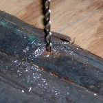 Remove old rivets by using successively larger drill bits to cut the existing peened end free.