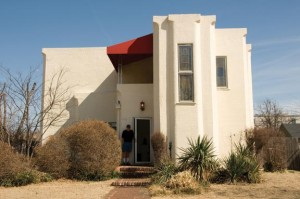 Thomas Thixton's home in Tulsa, Oklahoma, is an early example of the Art Deco style. Designed by Bruce Goff in 1922 and completed in 1924, the house embodies Deco's most recognizable hallmarks, including strong vertical lines, stucco walls, and chamfered corners.
