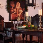 Quietly decorated for the winter holidays, the dining room is a period piece boasting three examples of late-1700s English oak furniture.