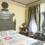 """A set of Victorian painted """"cottage furniture,"""" antiques from a local manufacturer, is perfect in the bedroom."""