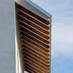 The galvanized metal roof's deep overhangs help keep the house cool in the summer months.