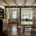 Murray re-created the dining room in the original portion of the house with exposed beams and salvaged flooring