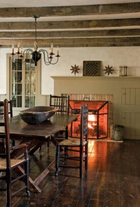 A simple colonial mantel dresses the fireplace in the dining room.