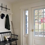 In the mudroom, Murray incorporated beadboard, shelving, and dog-eared molding around the door to keep the look simple.