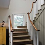 A winding staircase in the back hall is simple, with tapered balusters and curved handrail.