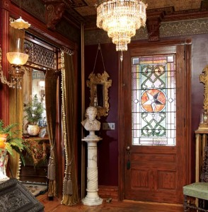 The entry is done in full Victorian finery; the owner had to buy back the stained-glass panel in the front door.
