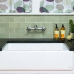 The apron-front sink and wall-mounted faucet are authentic period touches.