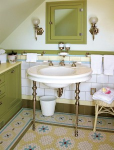 The restored bathroom in an 1894 house boasts a complex mosaic floor that resembles a richly detailed rug.