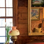 Gilding on an Empire-style pier mirror is a formal touch against original paneling. Judy Larter's mother did the reverse painting on glass, an image of Mount Vernon.