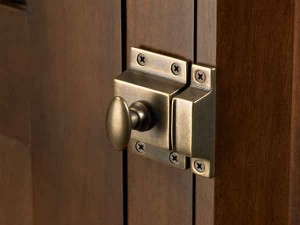 A simple cabinet latch from Top Knobs has a patinated finish for an aged look