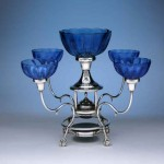 Silver epergne (a centerpiece for flowers or sweets) with ball-and-claw feet and blown-glass bowls, by Steve Smithers.