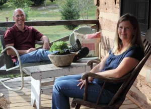 Andy and Barbara Twigg enjoy the cabin's porch.