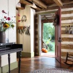 Vertical plank walls and reclaimed flooring run through the log addition.