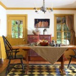 The dining room is lively with mustard on the trim and a painted floorcloth made by the owner.