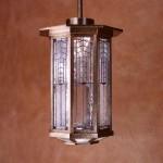 A bronze and art glass pendant from Crenshaw Lighting was originally a custom order.