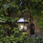 Alterations to an exterior wall lantern from Brass Light Gallery included making the curved arm mount longer and deeper so the fixture would stand out from a leaf-covered wall.