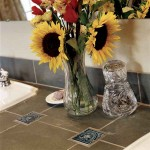 Amidst large countertop tiles, small relief decos won't break the budget.