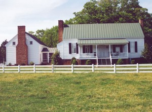 To allow the  historic portion of an 1828 Virginia farmhouse to remain visually distinct, the 700-square-foot garage  addition was  conceived as a detached  summer kitchen. The addition  was placed  perpendicular to the house with a screened-porch connector.