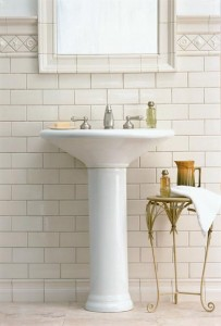 Pratt & Larson's 'Classic Cream' subway tile gains dimension from a baseboard treatment and relief decos at top.
