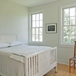 The bedrooms are austere in nature, reflecting the simple farmhouse style.