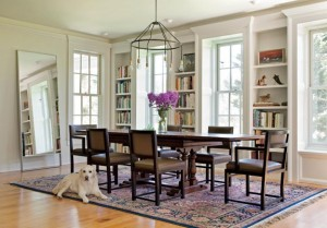 The dining room floods with light through generous six-over-six windows.
