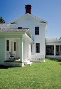 The mudroom is accessed through a small porch complete with a pediment and square columns.