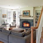 A stone fireplace warms the living room during Michigan's cold winters.