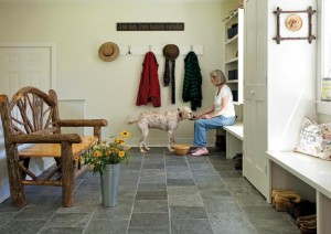 Stone flooring in the mudroom is a practical, durable alternative to wood.