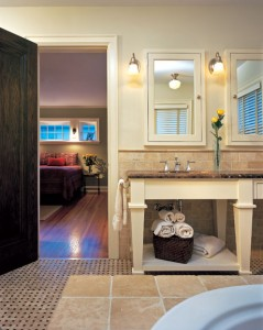 Recessed medicine cabinets, basket-weave tile, and 1920s-style light fixtures ground the luxurious master bathroom in the appropriate time period.