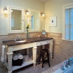 The furniture-like vanity further enhances the bathroom's period feel.