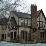 The new addition on the back of the house blends seamlessly into the old, thanks to matching stucco and half-timbers.