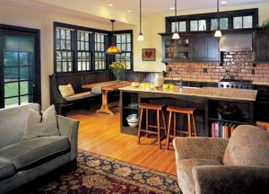 Period touches like Arts & Crafts-style pendants and an apron-front farmhouse sink provide a counterpoint to modern amenities like recessed lighting and a stainless steel range.