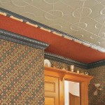 In a Victorian kitchen, the new ceiling is made up of multiple tin-ceiling components with polychrome painting.