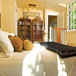 """The master bedroom is the only one in the house. The handrail with the """"M"""" cutout was a collaborative idea."""