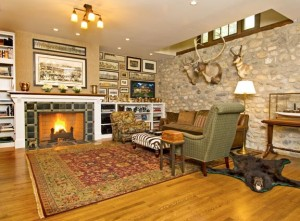 The Mahans sought furnishings specifically for their stone-walled cottage. Removing drywall to expose the river-stone wall uncovered an old light well that brings sunlight to the ground floor.