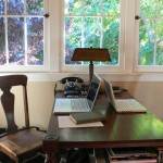 The couple share desk space in the upstairs loft, which doubles as a guest room. The rotary telephone is a Pottery Barn reproduction.